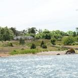 illustration villa sedd från vattnet